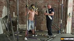 The boy is restrained in a cage of metal