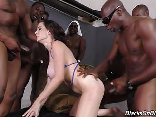 Busty MILF fucked by blacks in all holes