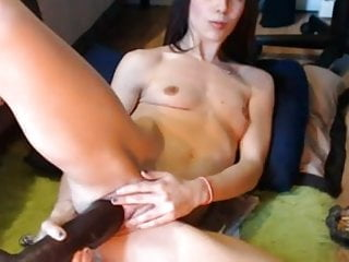 crazy slut takes on a big black dildo