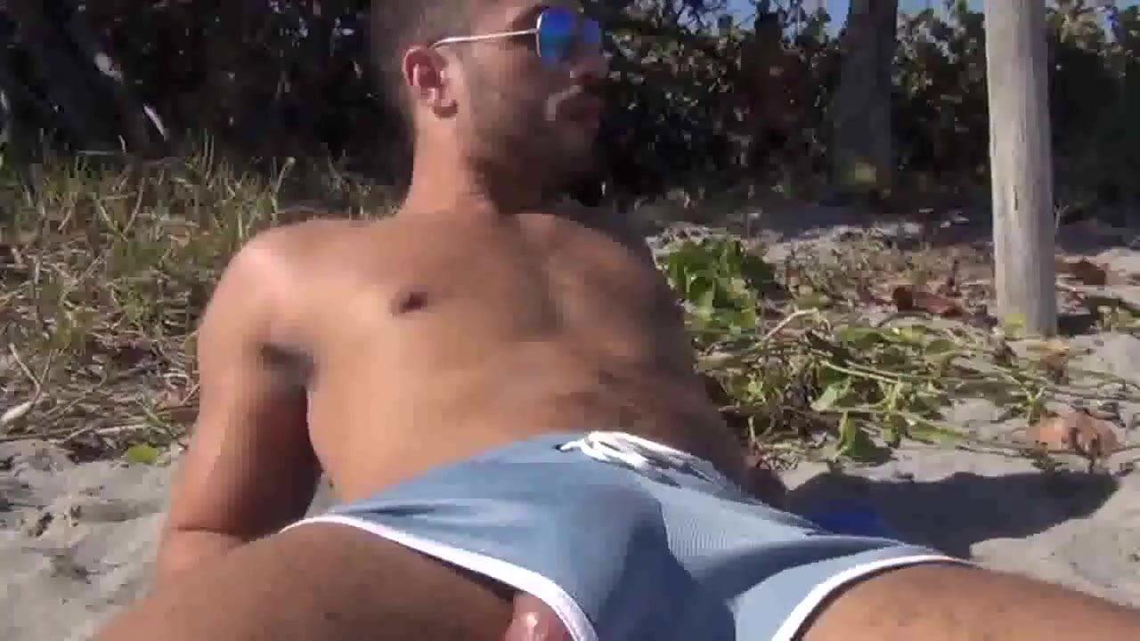 Sexy jock pulls his cock at the beach