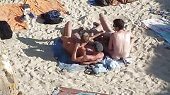 Group of guys having sex on the beach