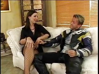 Sexy MILF in fishnets gets her pussy licked by young guy then gets drilled