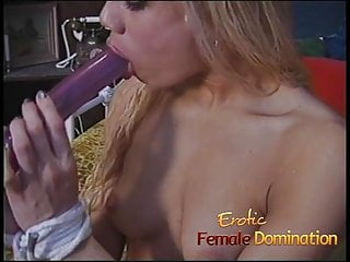 Sexy slave cleans all the sex toys with her wet mouth