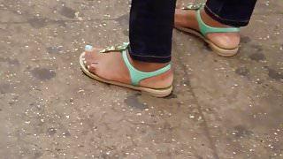 Candid ebony feet waiting for train