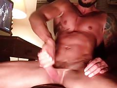 Muscele gay jerks while he looks porn