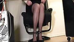 legs under a desk