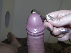 Teasing his cock and balls with vibrator.