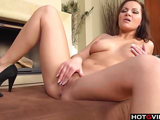 Euro chick fingerfucks herself on the couch