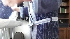 Ironing in bathrobe