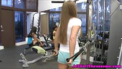 Lesbian menage a trois at the gym