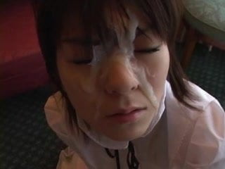 japanese doll takes a very nice facial between the eyes