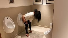 London girl uses urinal in mens toilet