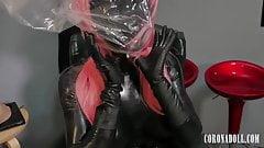 Black fully enclosed latex kigurumi's Thumb