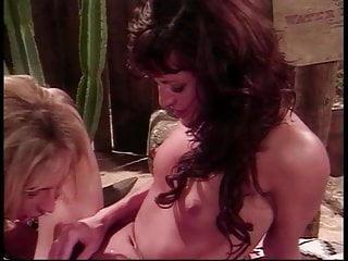 Two sexy whores take turns sucking stiff cock