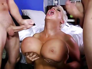 bimbo mature loves to fuck two young cocks