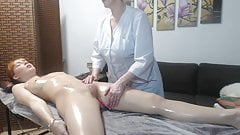 Mature woman doing relaxing massage to naked girl