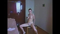young girl dances a striptease with a tulle