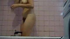 My mom washing in bathroom. Great body