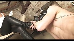 Leaving the cage to lick the mistress boots