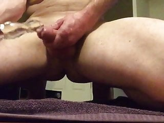 Bi guy lubes toy with precum then fucks his ass with it