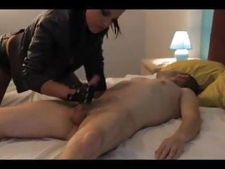 Beautiful mistress plays with his cock and feed him his cum
