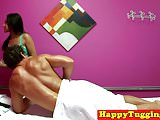 Asian massage therapist tugging client