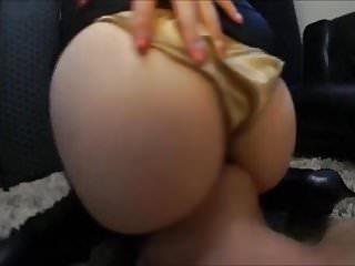 Asian in gold satin panties face sitting
