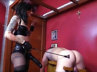 Cruel mistress fucks slave with a strapon