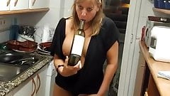Spanish milf after dinner playing with wine bottle