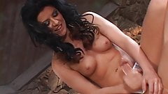 Slutty brunette beats off fat cock and covers pointy nipples in cum on bed