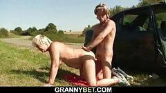 Guy doggy-fucks very old blonde granny roadside