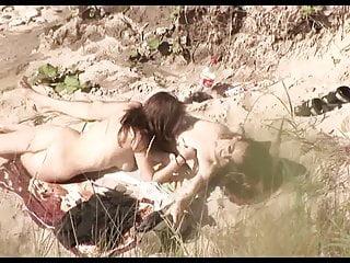 Voyeur on public beach. Hot young couple sex