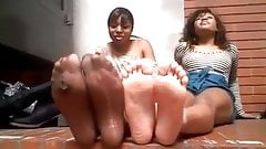 Two sexy black teens show off their sexy feet together.