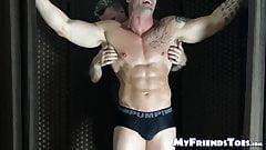 Bound muscular dude endures tickling from a mature deviant