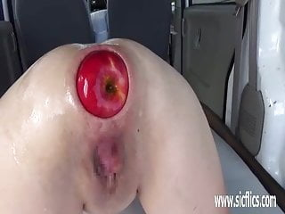 Fisting and fucking her gaping ass with huge apples