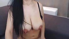 Hot brunette with giant tits rubs asshole with finger