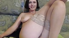 sweetie mommy is enjoying a black dildo in front of the came