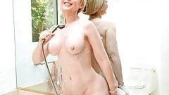 Busty Nina Hartley masturbating in the bathroom
