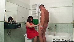Big boobs mother helps him cum in the bathroom