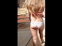 Hot blonde bombshell in two bikinis