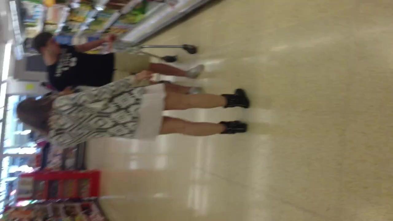 Milf upskirted filling her shopping basket