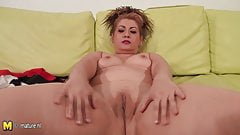 Mature mom playing on her couch with herself