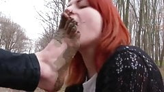 Lesbian slave is sucking on muddy toes.