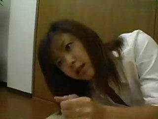 Cute Asian Girl giving a handjob