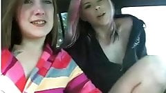lesbians inside car in parking lot