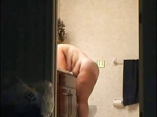 Hidden cam in bathroom. See milf fully nude