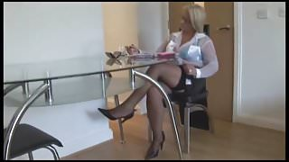 Busty mature blonde in fishnet stockings