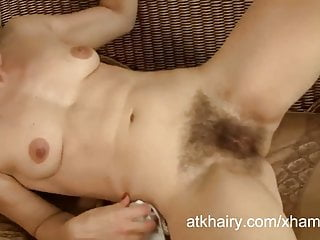 Lora is stuffing her hairy pussy with her panties.