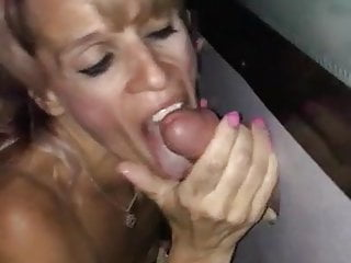 Sexual freak sucks a fat cock at the glory hole
