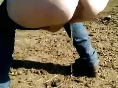 Outdoor bbw pee with large ass bending over with jeans down Thumbnail